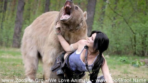 202081864 0270 fun beautiful girl poses with a bear for lara croft cosplay - Beautiful Girl Poses With A Bear For Lara Croft Cosplay